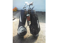 old golf clubs and balls