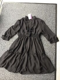 Black, short dress/top,size 10/12, brand new with tags