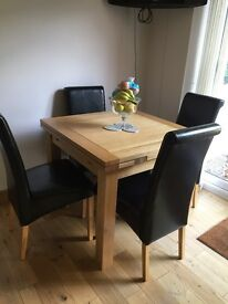 Solid oak extending table and 4 real leather chairs. Immaculate. Hardly used.