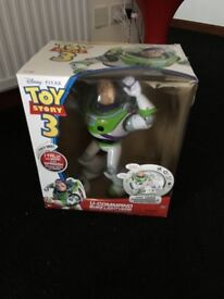 Toy story buzz talks and moves, still in box. In goid