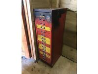Metal tool storage cabinet complete with assorted tools and bits