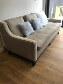 Large grey sofa with a sheen