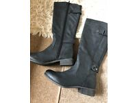 ladies size 7 knee high boots never been worn