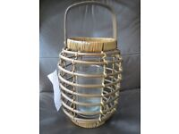 Next wicker candle holders two matching 15 inches tall with glass candle inserts