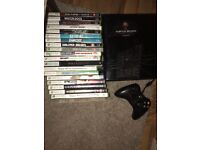 Xbox 360 console with 20 extra games and a controller