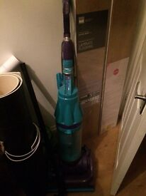 Purple and turquoise Dyson in need of repair