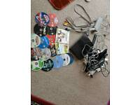 Black Nintendo Wii Console with numerous controllers/games bundle