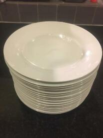 Sixteen 9 inch white plates. Unused as new.