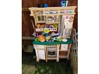 Toy kitchen with food, utensils etc