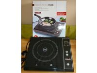 Electric table top induction hob. Never used.