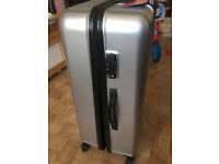 new silver suitcase