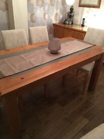 Solid table with glass