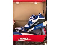 Blue and white Nike Air Max 90 trainers