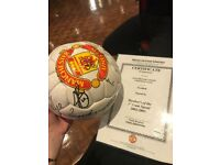 Signed football with certificate