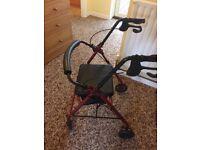 Walking aid 4 wheeled with seat storage