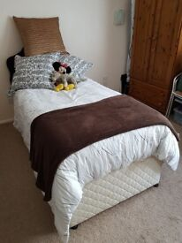 Divan bed, full 3ft single with pull-out bed beneath to make super-king or 2 full-size singles.