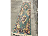 Runner rug , mostly blue in colour . In good condition. Size L 92in x W 27in.