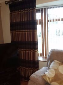 Luxurious living-room CURTAINS, heavily lined with triple pleat.