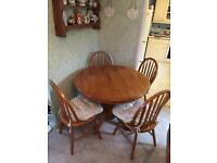 Solid pine 4 seat dinning table a chairs
