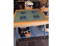 Chrome, glass and wood dining table with 4 chairs