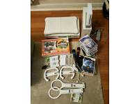 Nintendo Wii and Wii Fit Bundle plus 22 games