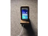 Recycled wooden phone charging stand.