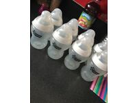8 large Tommee Tippee bottles with vari-flow teats