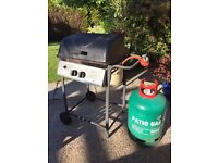 Barbeque and full 13KG bottle of patio gas