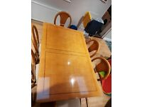 Large table with 6 chairs plus cabinet