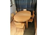 Ikea Bjursta extending dining table and 8 chairs.