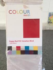 Red Venetian blinds new in box