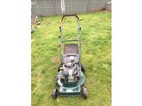 Petrol self propelled lawnmower