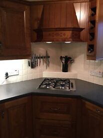 Solid wood kitchen units and integrated appliances