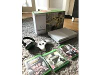 Practically brand new x box one for sale with games and accesories