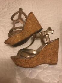 Metallic silver cork wedged heels