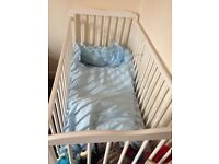 White cot & blue bedding