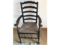 Oak ladder back carved chair, rush seat