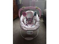 Comfort and harmony pink vibrating baby bouncer