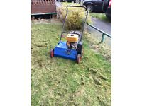 Grass scarifying machine