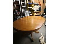 Good condition round extending dining room table, buyer to collect