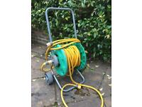 20 metres of hose and reel Hozelock tap connector
