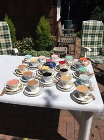Various tea cup candles for sale