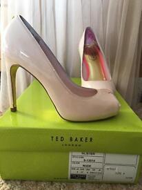 Nude, peep toe high heels
