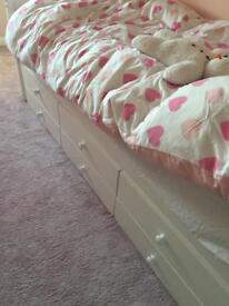 White single bed and sleeper