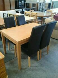Wooden dining table with leather covered chairs
