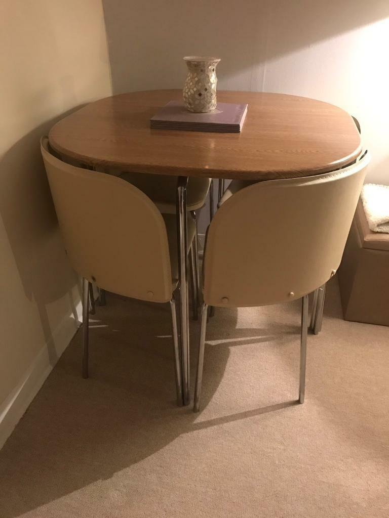 Argos space saver cream & oak hygena dining table and four ...
