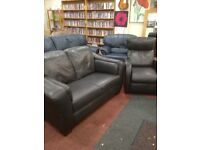 Brown leather 2 seater sofa with Manuel recliner armchair