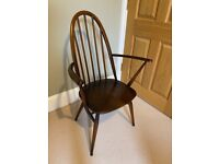 Antique wooden chair with arms