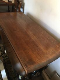 Solid oak dining table with gate leg mechanism and 4 chairs