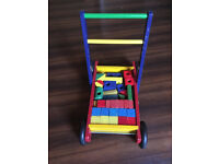 Traditional baby walker with assorted coloured bricks